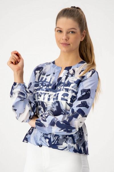 Hellblaue Bluse mit floralem Print und Glitzer von JUST WHITE